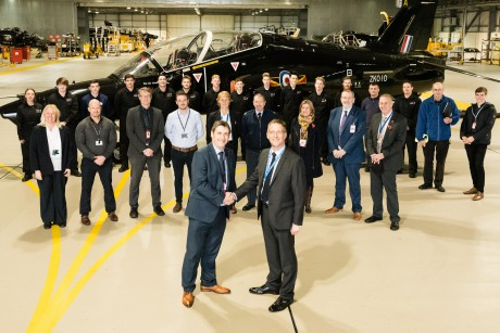 Dafydd Evans (L), CEO of Grwp Llandrillo Menai, with Rowly Fielder (R), Engineering Director of Babcock Aerospace in front of the Apprentice training team and apprentices in the Hawk T2 Hangar