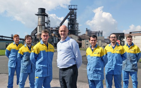 Training delivery manager Huw Mathias with apprentices at Tata Steel in Port Talbot.