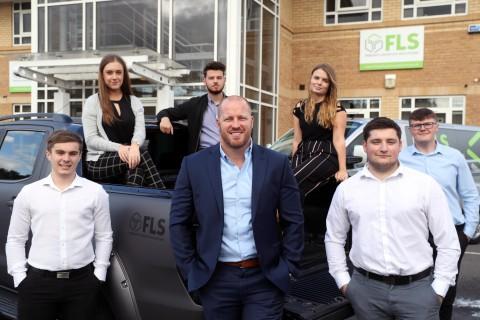 FLS managing director Ieuan Rosser with apprentices.